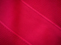 Sports clothing fabric jersey texture. Red sports clothing fabric jersey texture Royalty Free Stock Images