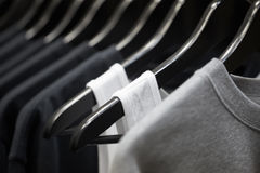 Sports clothing on hangers. Abstract background Royalty Free Stock Photos