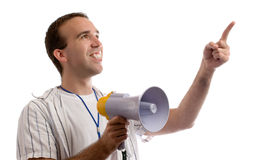 Sports Coach. A young man holding a megaphone and pointing at white copyspace Stock Photography