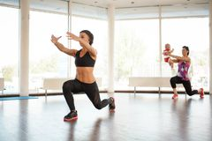 The sports coach gives a lesson in the gym with panoramic windows. A sports coach gives a lesson in the gym with panoramic windows for moms and children Stock Photos