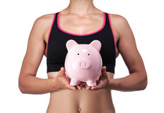 Sports coach holding a piggy bank Stock Images
