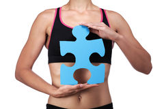 Sports coach holding a puzzle piece Royalty Free Stock Photos