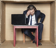 Sports commentator with headache Royalty Free Stock Photos