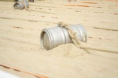 Sports competition with a barrel and a rope. On the beach stock images