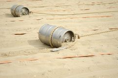 Sports competition with a barrel and a rope. On the beach royalty free stock photography