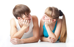 Sports couple is lying in the studio Stock Photography