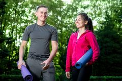 Sports couple in the park Royalty Free Stock Image
