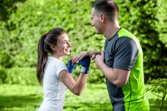 Sports couple in the park Royalty Free Stock Photography