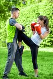 Sports couple in the park Royalty Free Stock Photos