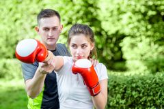 Sports couple in the park Royalty Free Stock Images