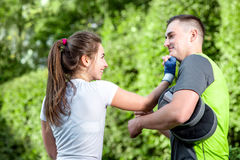 Sports couple in the park Stock Images