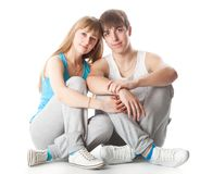Sports couple is sitting in the studio Royalty Free Stock Photography