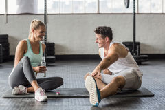 Sports couple taking break and talking together Stock Photos