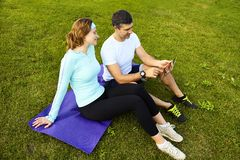 Sports couple using digital tablet Stock Photography