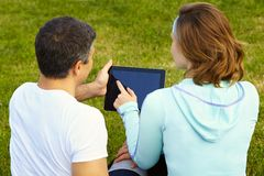 Sports couple using digital tablet Royalty Free Stock Images
