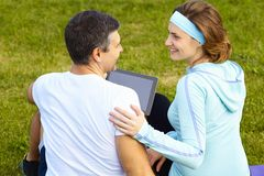 Sports couple using digital tablet Royalty Free Stock Photos