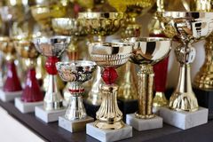 Sports cups, trophies on the shelf, golden and silver. Victory concept. stock photography
