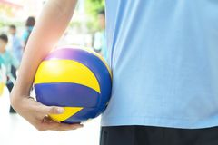 Volleyball players hold the ball with their right hand. stock photo
