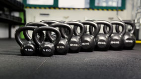 Sports dumbbells in modern sports club. Weight Training Equipment Stock Images