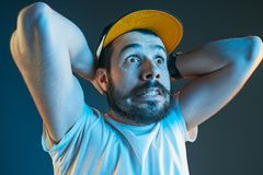 Sports, emotions and fan people concept - sad man watching sports on tv and supporting team at home. Sports, fan human emotions and people concept - sad young royalty free stock photo