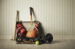 Sports equipment. Old Suitcase with sports equipment Royalty Free Stock Photos