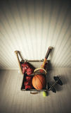 Sports equipment. Old Suitcase with sports equipment stock image