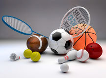 Sports equipment. Assorted sports equipment including a basketball, soccer ball, tennis ball, baseball, tennis racket, football, birdie, badminton racket Royalty Free Stock Image