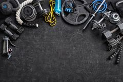 Sports equipment on a black background. Copy space. Sports equipment on a black background. Top view. Motivation. Copy space Royalty Free Stock Image