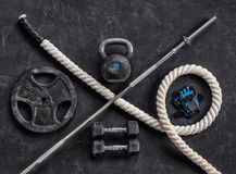 Sports equipment on a black background. Top view. Motivation. Close up Stock Photos