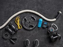 Sports equipment on a black background. Top view. Motivation. Close up Royalty Free Stock Photography