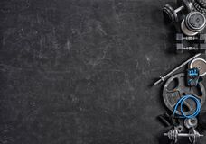 Sports equipment on a black background. Top view. Motivation. Copy space Stock Photography