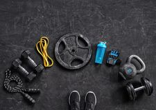 Sports equipment on a black background. Top view. Motivation. Close up Stock Photography