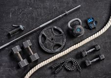 Sports equipment on a black background. Top view. Motivation. Close up Stock Images