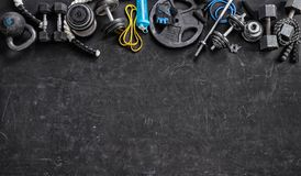 Sports equipment on a black background. Copy space. Sports equipment on a black background. Top view. Motivation. Copy space royalty free stock photography