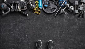 Sports equipment on a black background. Top view.  Copy space. Sports equipment on a black background. Top view. Motivation. Copy space Stock Photography