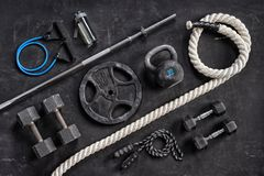 Sports equipment on a black background. Top view. Motivation Stock Photography