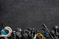 Sports equipment on a black background. Top view. Motivation. Copy space Royalty Free Stock Photography