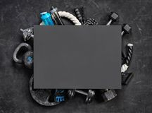 Sports equipment with board for copy space on a black background. Top view. Motivation Stock Photography