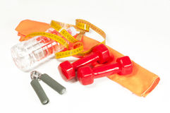 Sports equipment, centimeter and a bottle with water Stock Photography