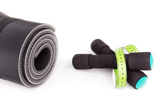 Sports equipment for fitness. Dumbbells, meter. Royalty Free Stock Images