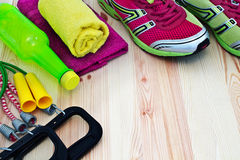 Sports equipment. For fitness on a light wooden background Royalty Free Stock Photo