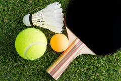 Sports equipment on grass Royalty Free Stock Photos