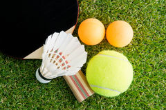 Sports equipment on grass Royalty Free Stock Photo