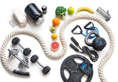 Sports equipment and healthy nutrition on a white background. Top view. Motivation Stock Photo