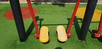 Sports equipment for individual legs training. In outdoor gym at city park royalty free stock photo