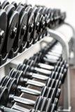 Sports equipment lying on shelves.Gym.Dumbbells Stock Photos