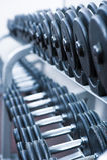 Sports equipment lying on shelves.Gym.Dumbbells Stock Photo