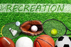 Free Sports Equipment On Field With Recreation Painted On Grass Royalty Free Stock Images - 153164489