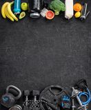 Sports equipment and organic food on a black background. Top view. Motivation Stock Photos