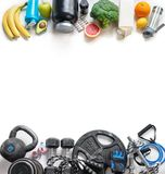 Sports equipment and organic food on a white background. Top view. Motivation. Copy space Royalty Free Stock Photography